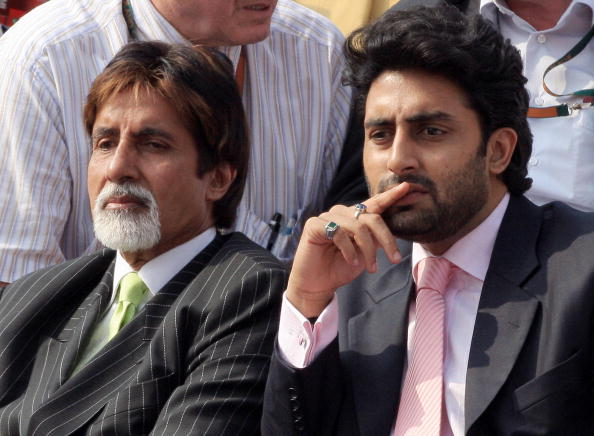 Indian actors Abhishek Bachchan (R) and