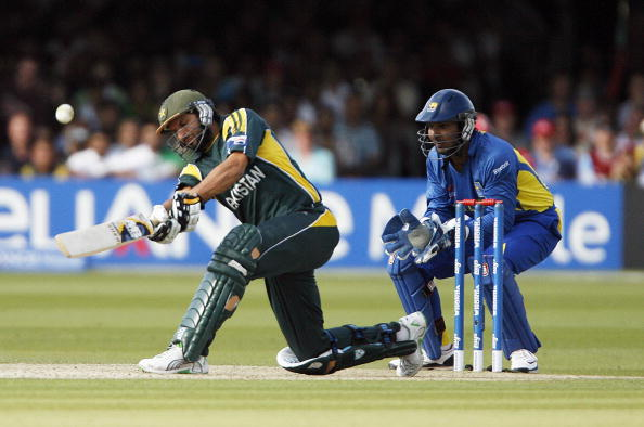 Shahid Afridi (L) of Pakistan hits a six