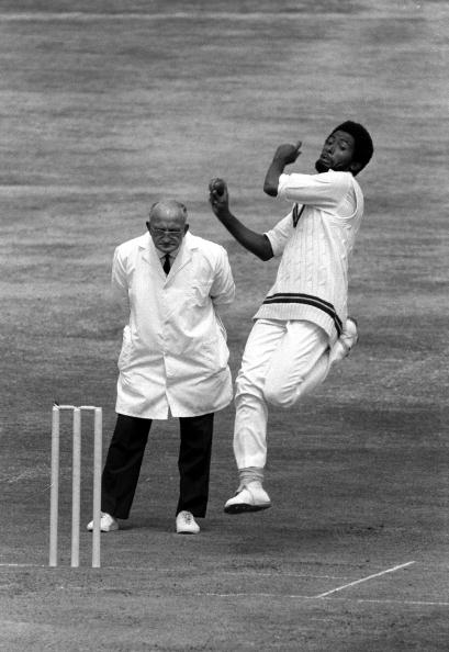 Cricket. 1976. 4th Test Match. Headingley, Yorkshire. England v West Indies. West Indies won by 55 runs. A picture of West Indies fast bowler Andy Roberts about to send down a delivery. The umpire is Tom Spencer.
