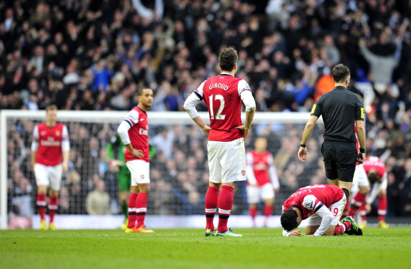 Arsenals players react after conceding the second goal during the English Premier League football match between Tottenham Hotspur and Arsenal at White Hart Lane in north London on March 3, 2013.