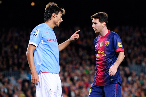 BARCELONA, SPAIN - NOVEMBER 03:  Lionel Messi of FC Barcelona (R) argues with Jonathan Vila of RC Celta de Vigo during the La Liga match between FC Barcelona and RC Celta de Vigo at Camp Nou on November 3, 2012 in Barcelona, Spain.