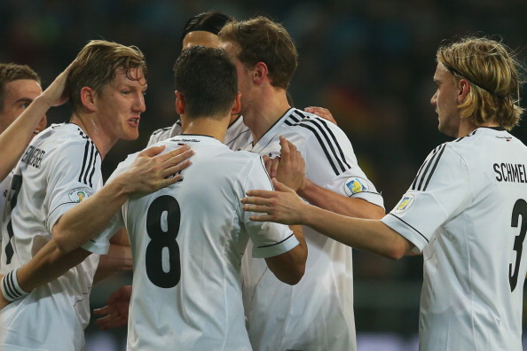 ASTANA, KAZAKHSTAN - MARCH 22:  Bastian Schweinsteiger (2nd L) of Germany celebrates scoring the opening goal with his team mates during the FIFA 2014 World Cup qualifier group C match between Kazakhstan and Germany