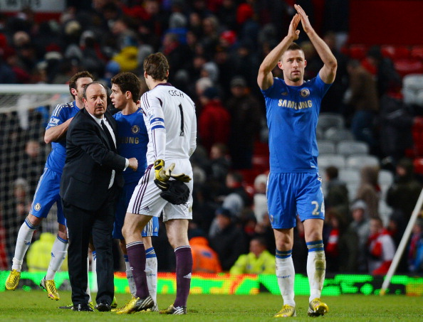 Chelsea's Spanish manager Rafael Benitez (L) shakes hands with his players after their English FA Cup quarter-final football match between Manchester United and Chelsea at Old Trafford, Manchester, northwest England on March 10, 2013. The match ended 2-2.