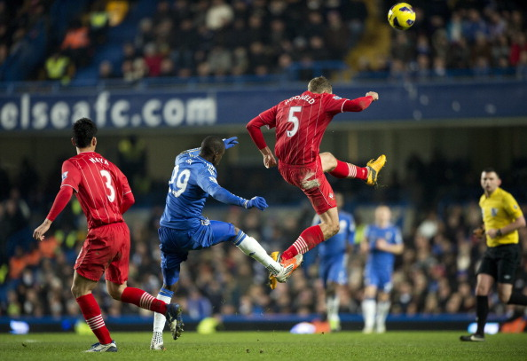 Southampton's Dutch defender Jos Hooiveld (2nd R) clears the ball under pressure from Chelsea's French-born Senegalese striker Demba Ba (2nd L) during the English Premier League football match between Chelsea and Southampton at Stamford Bridge in London, on January 16, 2013. The game finished 2-2.