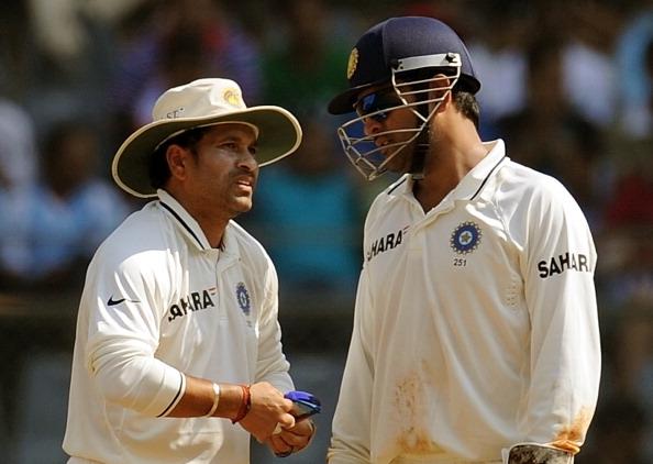 Indian captain Mahendra Singh Dhoni (R)