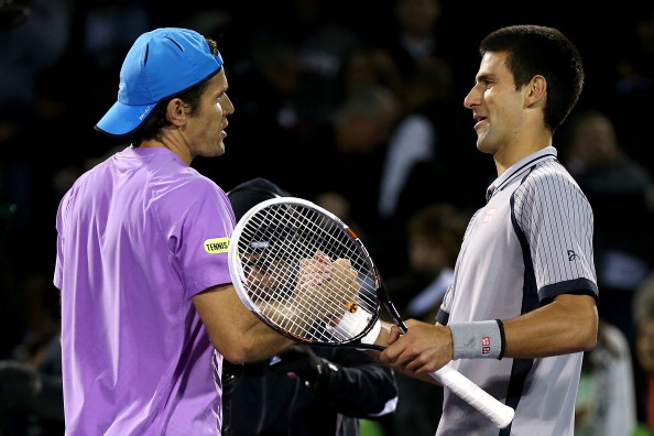 KEY BISCAYNE, FL - MARCH 26:  Tommy Haas of Germany is congratulated by Novak Djokovic of Serbia after their match during the Sony Open at Crandon Park Tennis Center