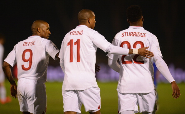 aniel Sturridge of England is congratulated by team mates Jermain Defoe and Ashley Young after scoring during the FIFA 2014 World Cup Qualifier Group H match between San Marino and England at Serravalle Stadium on March 22, 2013