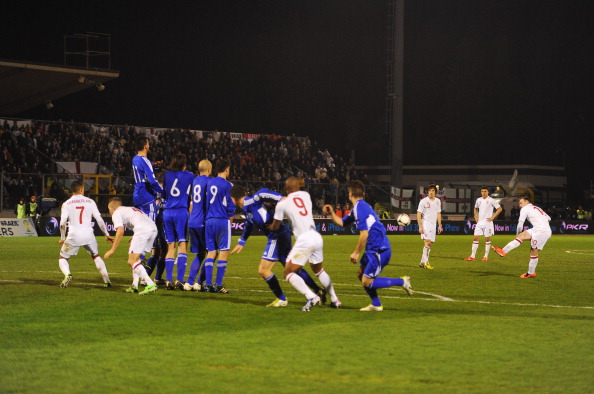 SERRAVALLE, SAN MARINO - MARCH 22:  Wayne Rooney of England scores from a free kick during the FIFA 2014 World Cup Qualifier Group H match between San Marino and England