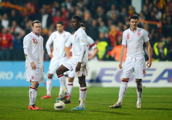 PODGORICA, MONTENEGRO - MARCH 26:  (L-R)Wayne Rooney, Danny Welbeck and Michael Carrick of England look dejected during the FIFA 2014 World Cup Qualifier Group H match between Montenegro and England at City Stadium