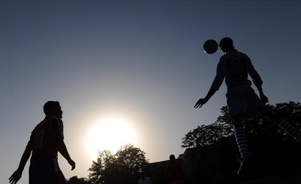 An Indian youth practices his football s
