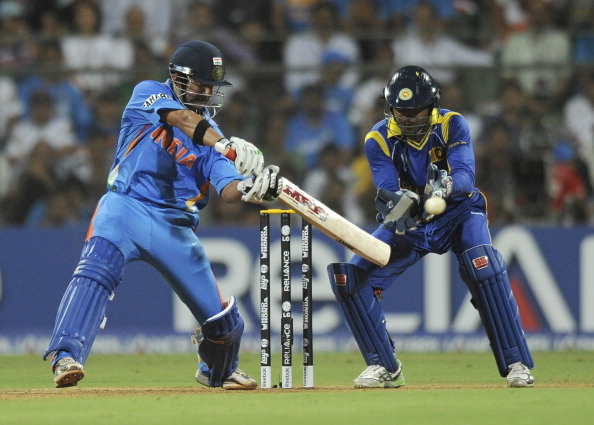 Indian batsman Gautam Gambhir (L), watched by Sri Lankan captain Kumar Sangakkara, plays a shot during the ICC Cricket World Cup final between India and Sri Lanka at Wankhede Stadium in Mumbai on April 2, 2011.
