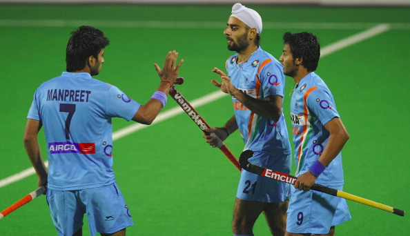 Gurwinder Singh Chandi of India (C) celebrates a goal