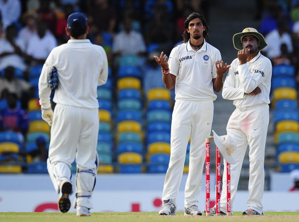 Indian bowlers Ishant Sharma (C) and Har