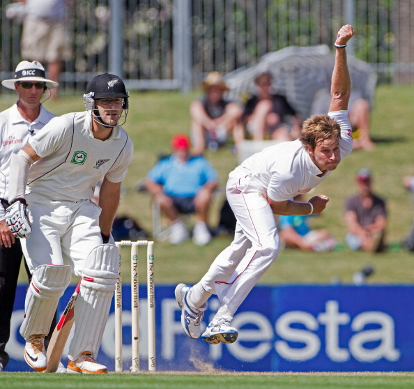 Zimbabwe's Kyle Jarvis (R) bowls on day