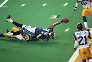 Kevin Dyson #87 of the Tennessee Titans is stopped one yard shy of winning the superbowl