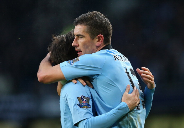 MANCHESTER, ENGLAND - MARCH 09:  Aleksandar Kolarov of Manchester City celebrates with David Silva after scoring the second goal during the FA Cup sponsored by Budweiser sixth round match between Manchester City and Barnsley at Etihad Stadium