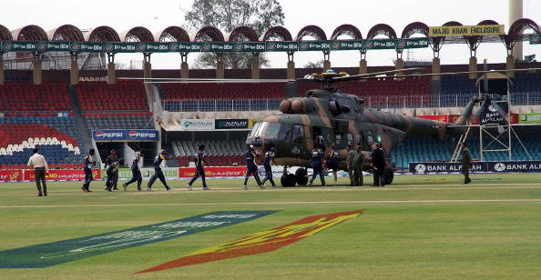 LAHORE, PAKISTAN - MARCH 03:  Members of the Sri Lankan international cricket team board a rescue helicopter at the Gadaffi Stadium on March 3, 2009 in Lahore, Pakistan. The team were attacked in a coach as it travelled through the heart of Lahore, leaving five Pakistani policeman dead and several team members injured.