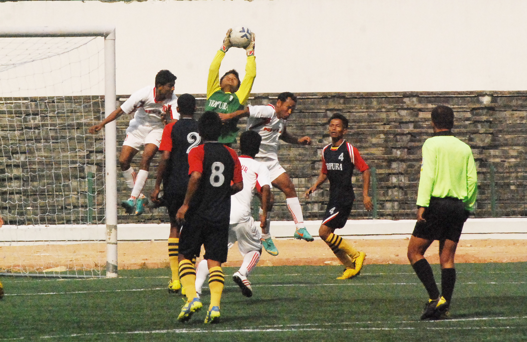 Manipur custodian, S Dinakumar rising above all for a magnificient save against the marauding Tripura lads.