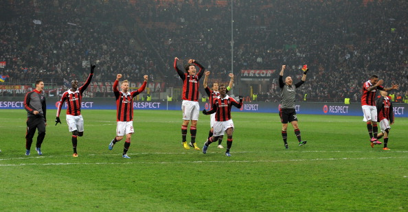 AC Milan's players celebrate at the end of the Champions League football match between AC Milan and FC Barcelona on February 20, 2013 at San Siro Stadium in Milan. AC Milan defeated FC Barcelona 2-0