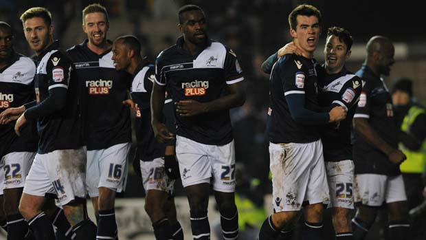 Millwall's English striker John Marquis (2-R)  celebrates after scoring the winning goal during the English FA Cup fourth round football match between Millwall and Aston Villa at The Den in south-east London on January 25, 2013.  Millwall won 2-1.
