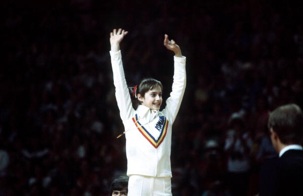 1976 Olympic Games, Montreal, Canada, Women's Gymnastics, All Round Competition, Romania's Nadia Comaneci celebrates winning the gold medal