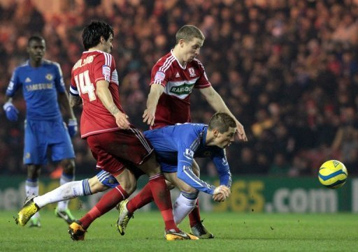 Chelsea's Fernando Torres (C) gets squeezed out during a match against Middlesborough, on February 27, 2013