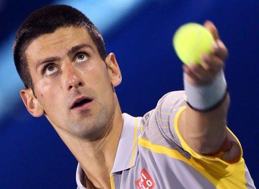Novak Djokovic serves at the Dubai Open on February 28, 2013