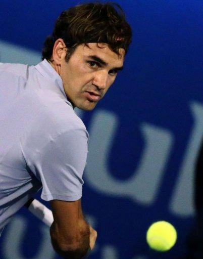 Roger Federer returns the ball at the Dubai Open on February 28, 2013