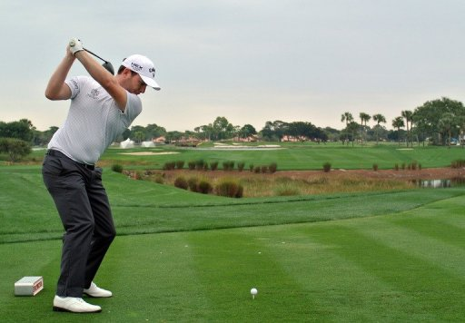 Branden Grace of South Africa plays a tee shot at the Honda Classic on February 28, 2013 in Palm Beach Gardens, Florida