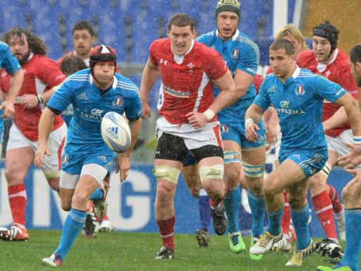 Ian Evans (C) of Wales vies with Kristopher Burton (L) of Italy during the Six Nations rugby, February 23, 2013  in Rome