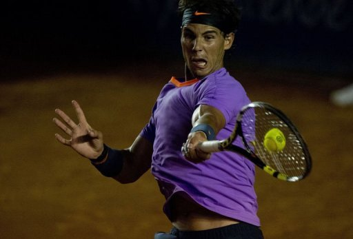 Rafael Nadal of Spain hits a return to Leonardo Mayer of Argentina in Acapulco, Guerrero state on February 28, 2013