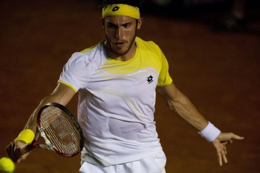 Leonardo Mayer of Argentina hits a return to Rafael Nadal of Spain in Acapulco, Guerrero state on February 28, 2013