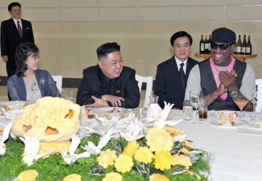 Kim Jong-Un (centre left), his wife Ri Sol-Ju and Dennis Rodman at a dinner in Pyongyang on February 28, 2013