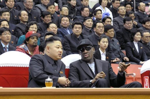 Kim Jong-Un (front left) and Dennis Rodman (front right) at a basketball game in Pyongyang on February 28, 2013