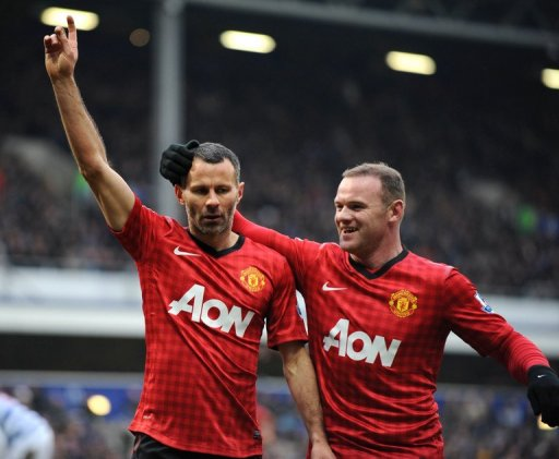 Ryan Giggs (left) celebrates with Wayne Rooney after scoring against QPR at Loftus Road on February 23, 2013