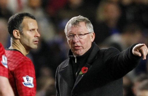 Alex Ferguson (right) gives orders to Ryan Giggs during a game against Chelsea at Stamford Bridge on October 31, 2012