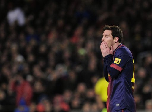 Barcelona's forward Lionel Messi reacts during their Spanish Cup match against Real Madrid on February 26, 2013