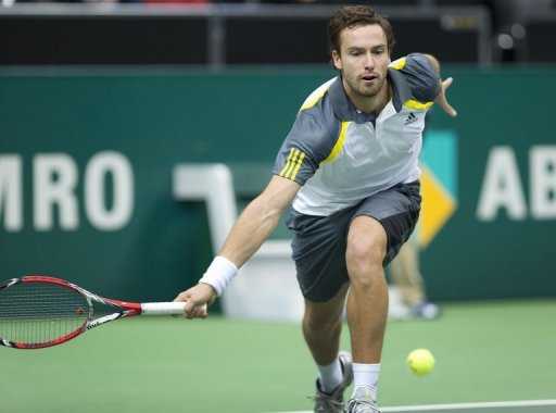Latvian Ernests Gulbis returns a shot on February 12, 2013 in Rotterdam