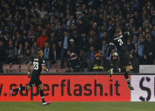 Juventus' defender Giorgio Chiellini (R) celebrates after scoring at San Paolo Stadium in Naples on March 1, 2013