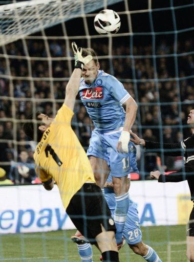 Juventus' goalkeeper Gianluigi Buffon (L) clashes with Napoli's Christian Maggio in Naples on March 1, 2013