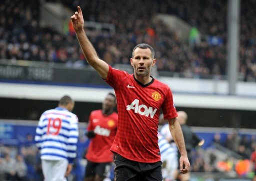 Manchester United's  Ryan Giggs celebrates scoring against Queens Park Rangers at Loftus Road February 23, 2013