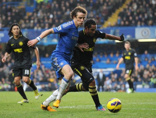 Chelsea's David Luiz (L) tries to run down  Wigan Athletic's  Jean Beausejour at Stamford Bridge on February 9, 2013