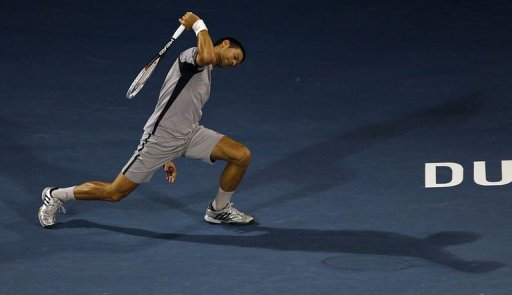 Serbia's Novak Djokovic returns the ball to Czech Republic's Tomas Berdych on March 2, 2013