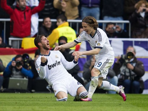 Real Madrid's defender Sergio Ramos (L) celebrates with midfielder Luka Modric after scoring in Madrid on March 2, 2013