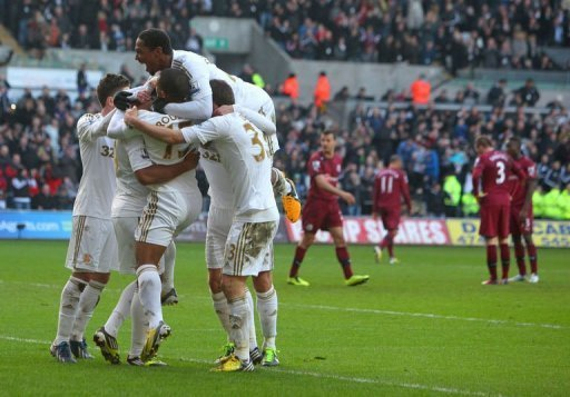 Swansea City's players celebrate Luke Moore's goal at Liberty Stadium in Swansea, south Wales, on March 2, 2013