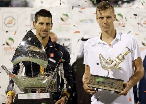 Serbia's Novak Djokovic (L) and Czech Republic's Tomas Berdych pose with their trophies, March 2, 2013
