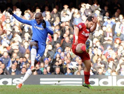 Chelsea's striker Demba Ba (L) shoots to score past West Bromwich Albion's striker Shane Long, March 2, 2013