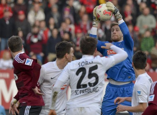 Freiburg's goalkeeper Oliver Baumann (2nd R) saves the ball in Nuremberg, southern Germany on March 2, 2013