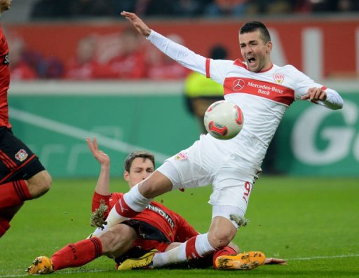 Leverkusen's Daniel Schwaab and Stuttgart's Vedad Ibisevic (R) fight for the ball on March 2, 2013
