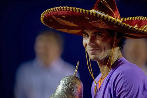 Rafael Nadal holds the winner's trophy after defeating David Ferrer at the Mexico ATP Open in Acapulco, on March 2, 2013